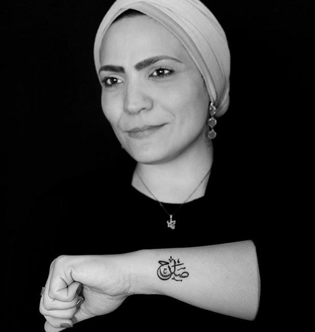 кубе находится фото татуировок на арабском кнопке